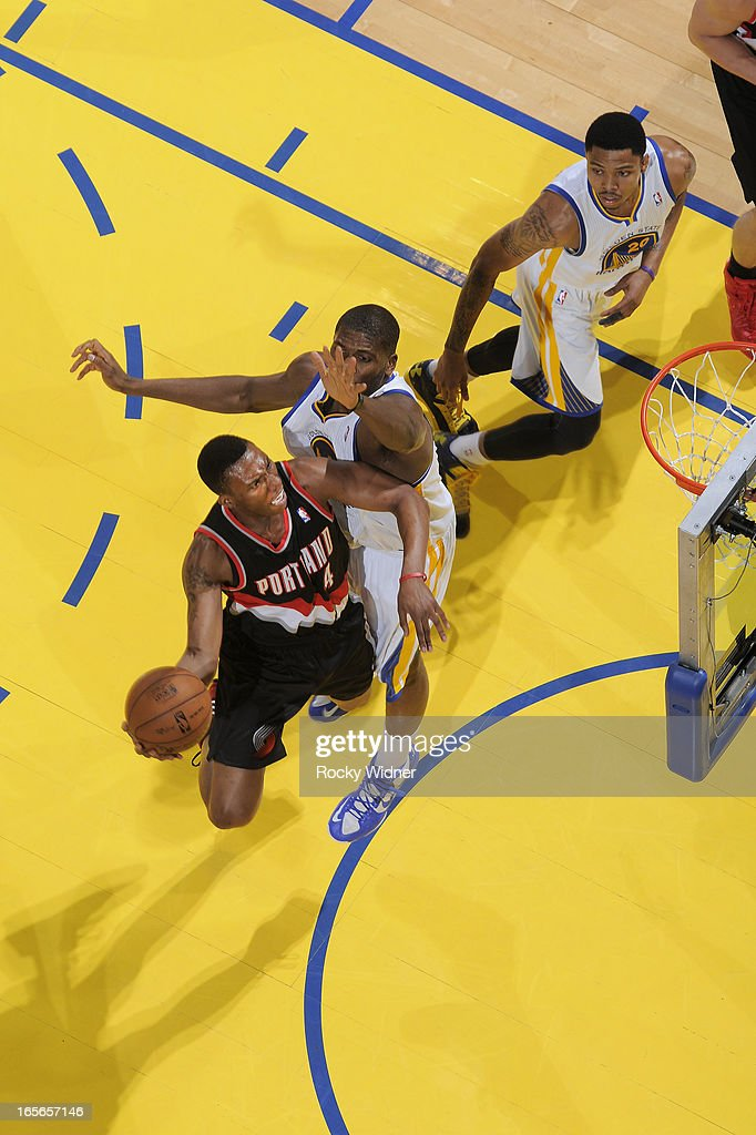 Nolan Smith #4 of the Portland Trail Blazers shoots against Festus Ezeli #31 of the Golden State Warriors on March 30, 2013 at Oracle Arena in Oakland, California.