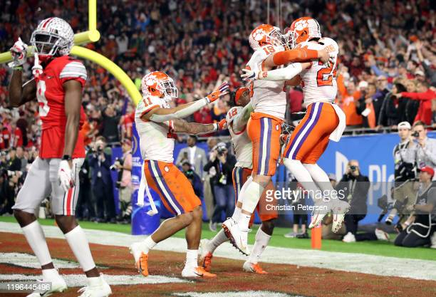 Nolan Turner of the Clemson Tigers is congratulated by his teammates after intercepting the ball in the final minute of the second half against the...
