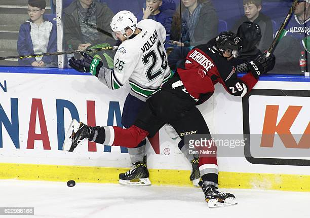 Nolan Volcan of the Seattle Thunderbirds checks Tristyn DeRoose of the Vancouver Giants during the second period of their WHL game at the Langley...