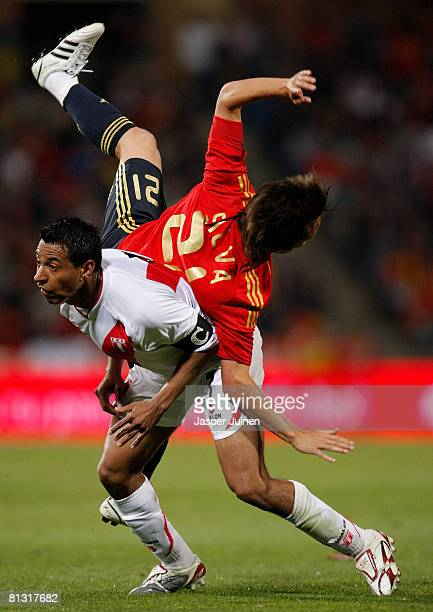 Nolberto Solano of Peru collides with David Silva of Spain during the international friendly match between Spain and Peru at the Nuevo Colombino...