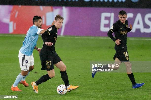 Nolito of Celta de Vigo Frenkie de Jong of FC Barcelona during the La Liga Santander match between Celta de Vigo v FC Barcelona at the Estadio de...