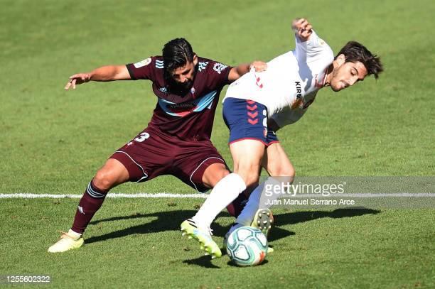 Nolito of Celta Vigo and Nacho Vidal of Osasuna battle for the ball during the Liga match between CA Osasuna and RC Celta de Vigo at on July 11 2020...