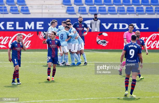 Nolito of Celta Vigo celebrates with team mates after scoring their side's second goal during the La Liga Santander match between SD Huesca and RC...