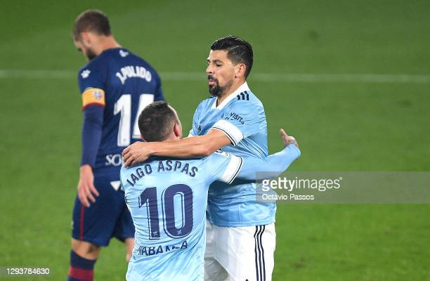 Nolito of Celta Vigo celebrates with teammate Iago Aspas after scoring their team's first goal during the La Liga Santander match between RC Celta...