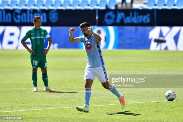 Nolito of Celta Vigo scores his sides first goal during the Liga match between RC Celta de Vigo and Real Betis Balompie at AbancaBalaídos on July 04...
