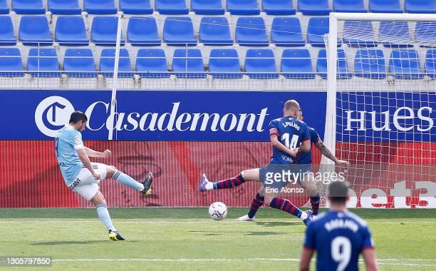 Nolito of Celta Vigo scores their side's second goal during the La Liga Santander match between SD Huesca and RC Celta at Estadio El Alcoraz on March...