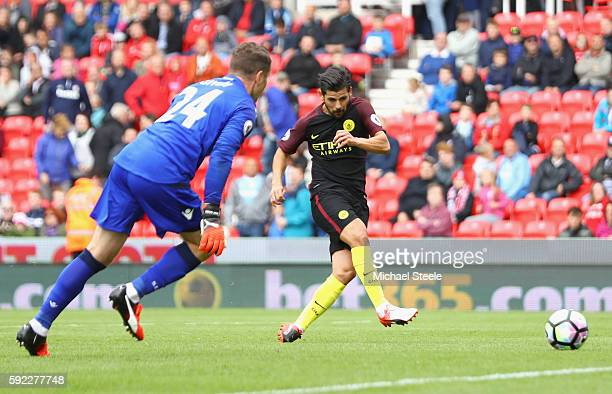 Nolito of Manchester City scores his sides fourth goal during the Premier League match between Stoke City and Manchester City at Bet365 Stadium on...