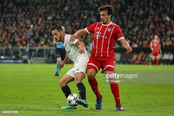 Nolito of Sevilla and Mats Hummels of Muenchen battle for the ball during the UEFA Champions League quarter final second leg match between Bayern...