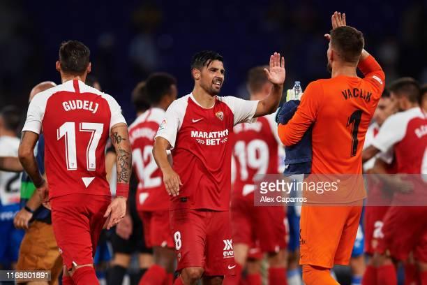 Nolito of Sevilla FC celebrates victory with his teammate Tomas Vaclik after the Liga match between RCD Espanyol and Sevilla FC at RCDE Stadium on...