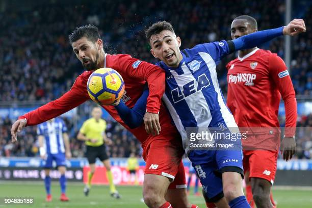 Nolito of Sevilla FC Munir El Haddadi of Deportivo Alaves during the La Liga Santander match between Deportivo Alaves v Sevilla at the Estadio de...