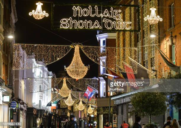 Nollaig Shona Duit and Christmas lights and decorations on Grafton Street, in Dublin's city center. The lights on Grafton Street, Henry Street, South...