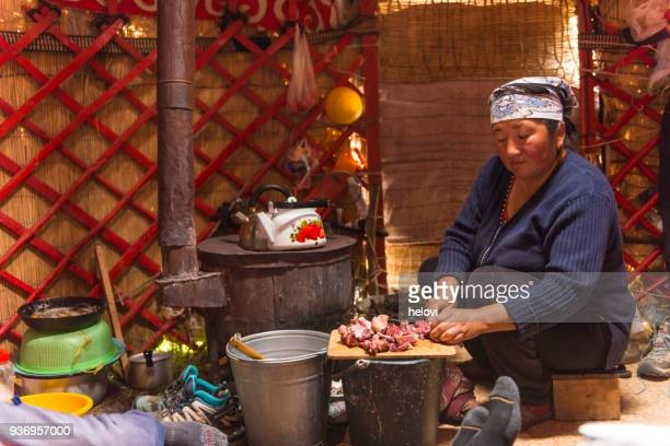 nomad women cooking in yurt - mongolian women stock photos and pictures