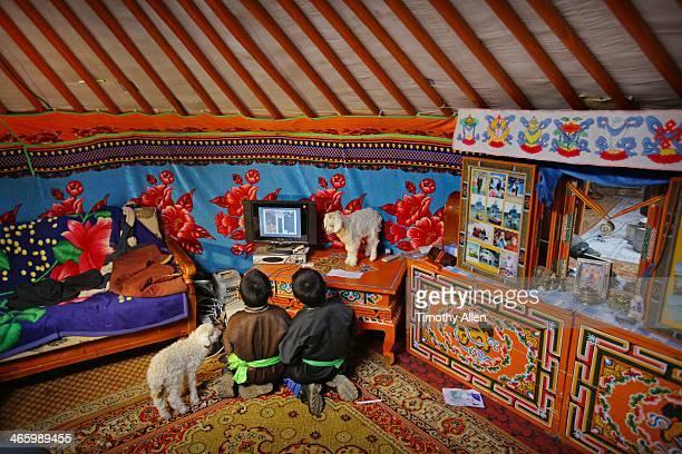 Nomadic boys play video game inside family ger