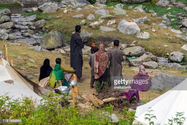 nomadic kashmiri gypsies family near a village mountain above naranag valley at kashmir, india. - shaifulzamri stock pictures, royalty-free photos & images