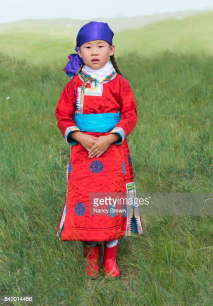 Nomadic Mongolian Little Girl in Traditional Outfit in Grasslands Inner Mongolia.