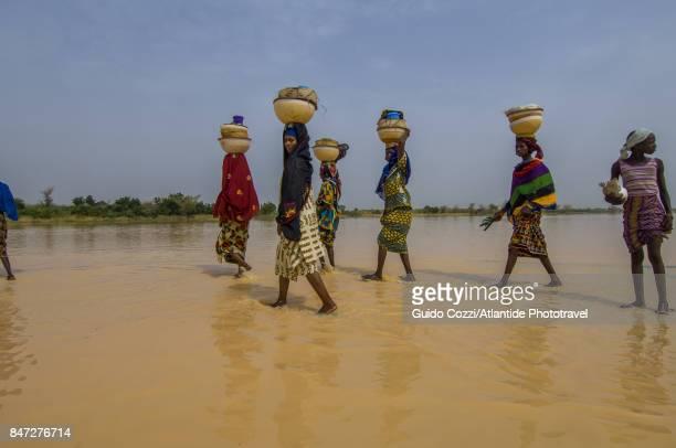 Nomadic people crossing a river near Birni Nkonni