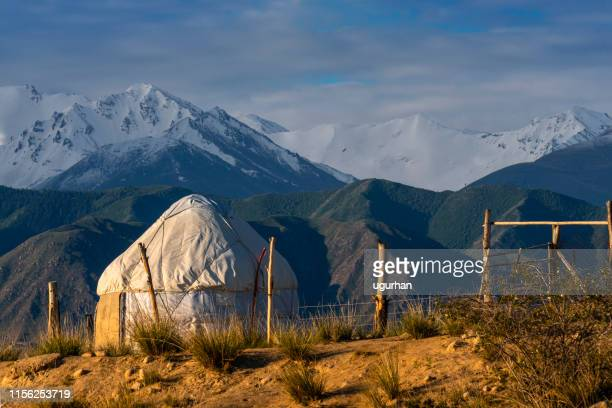 nomadic tents known as yurt at the issyk kul lake, kyrgyzstan - kyrgyzstan stock pictures, royalty-free photos & images
