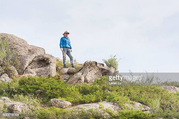 Nomadic young man standing on hill
