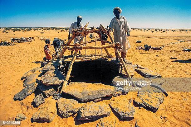 Nomads near a well SudaneseLibyan desert Sudan