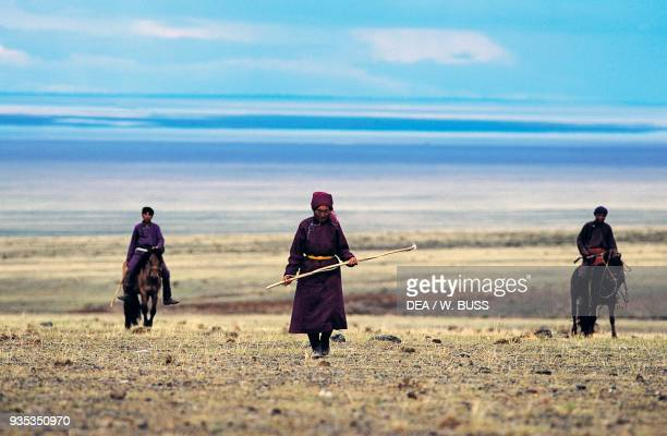 Nomads on foot and horseback Gobi desert Mongolia