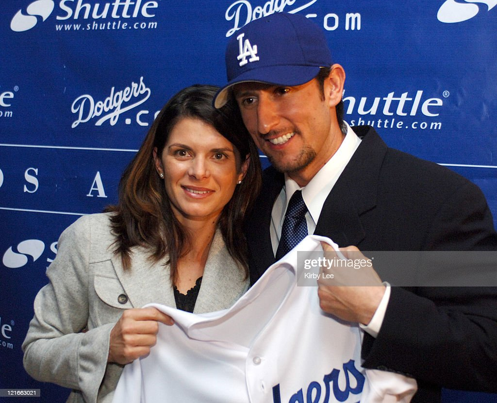 Nomar Garciaparra and his wife Mia Hamm pose with Los Angeles Dodger jersey at press conference to announce his signing to a one-year contract at Dodger Stadium in Los Angeles, Calif. on Monday, December 19, 2005.