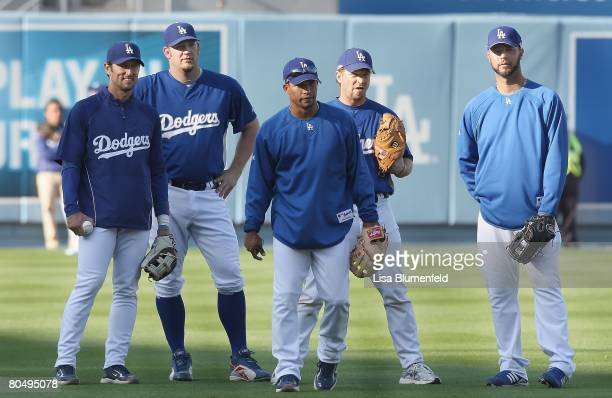 Nomar Garciaparra Brad Penny Rafael Furcal Gary Bennett and Esteban Loaiza of the Los Angeles Dodgers look on before the game against the San...