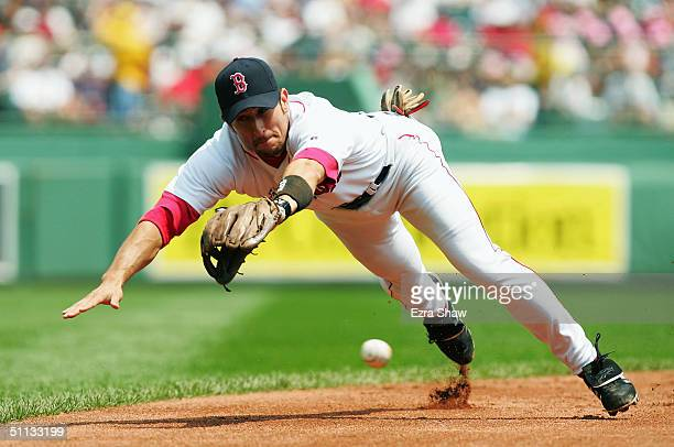 Nomar Garciaparra of the Boston Red Sox dives for a ball hit by Jerry Hairston of the Baltimore Orioles in the second inning July 22 2004 at Fenway...