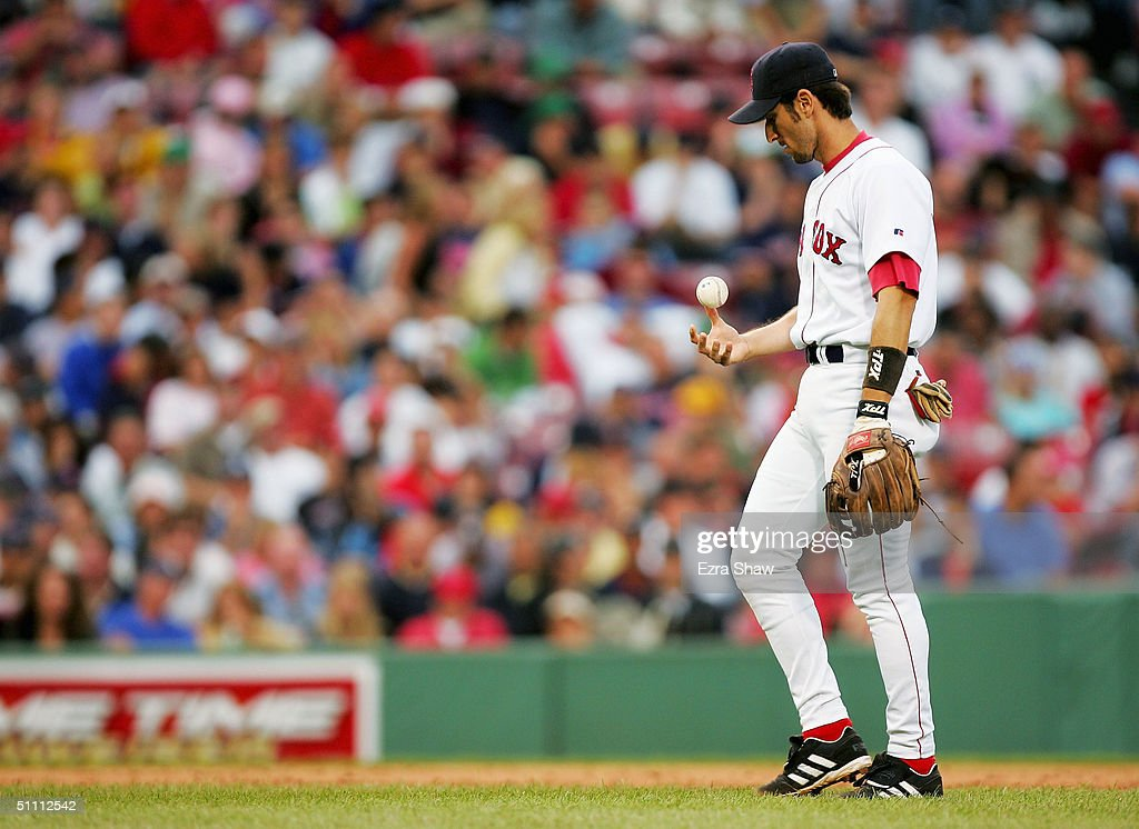 Nomar Garciaparra #5 of the Boston Red Sox looks down after making an error on a ball hit by Bernie Williams #51 of the New York Yankees in the seventh inning on July 24, 2004 at Fenway Park in Boston, Massachusetts.