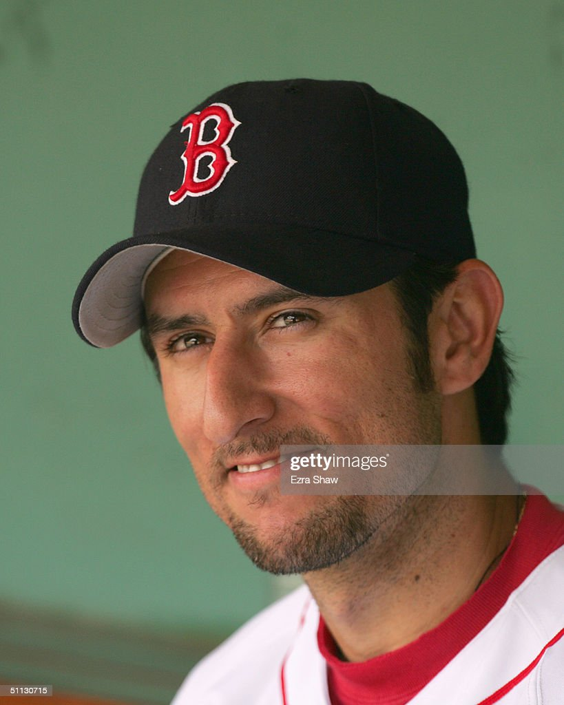 Nomar Garciaparra #5 of the Boston Red Sox looks on from the dugout during the game against the Baltimore Orioles on July 22, 2004 at Fenway Park in Boston, Massachusetts. The Orioles won 8-3.