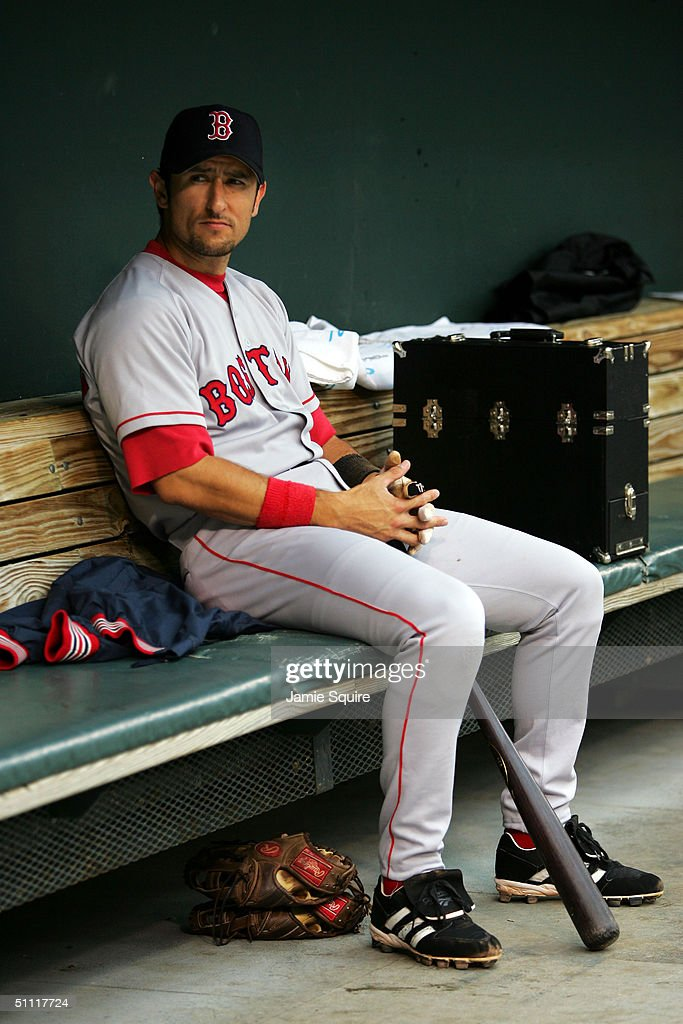 Nomar Garciaparra #5 of the Boston Red Sox sits in the dugout prior to the game against the Baltimore Orioles July 26, 2004 at Camden Yards in Baltimore, Maryland.