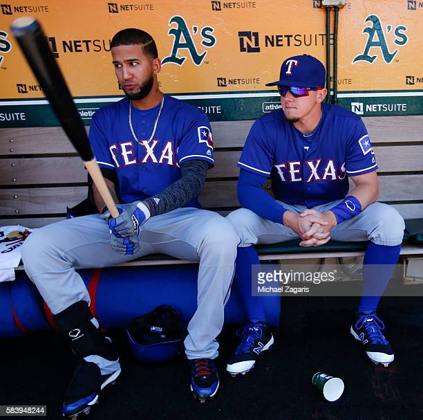 Nomar Mazara and Ryan Rua of the Texas Rangers sit in the dugout prior to the game against the Oakland Athletics at the Oakland Coliseum on June 16...
