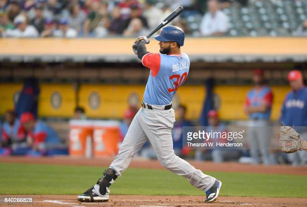 Nomar Mazara of the Texas Rangers bats against the Oakland Athletics in the top of the first inning at Oakland Alameda Coliseum on August 25 2017 in...