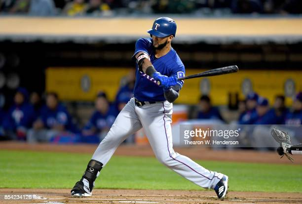Nomar Mazara of the Texas Rangers bats against the Oakland Athletics in the top of the first inning at Oakland Alameda Coliseum on September 22 2017...