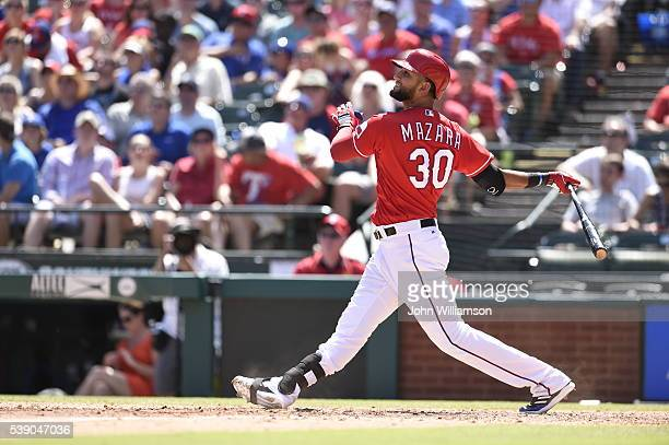 Nomar Mazara of the Texas Rangers bats against the Seattle Mariners at Globe Life Park in Arlington on June 5 2016 in Arlington Texas The Texas...
