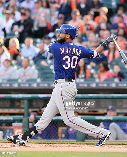 Nomar Mazara of the Texas Rangers bats during the game against the Detroit Tigers at Comerica Park on May 6 2016 in Detroit Michigan The Rangers...