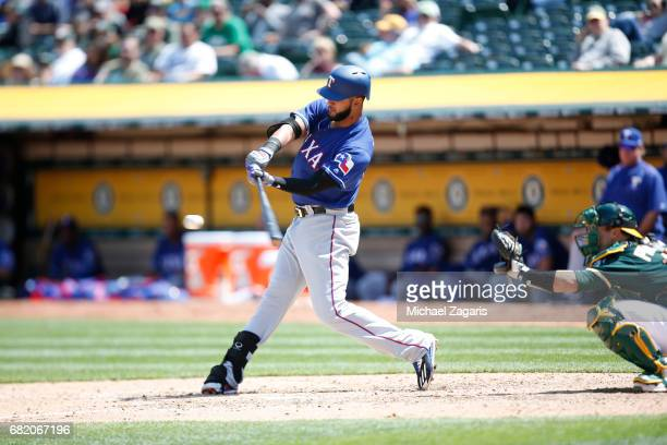 Nomar Mazara of the Texas Rangers bats during the game against the Oakland Athletics at the Oakland Alameda Coliseum on April 19 2017 in Oakland...