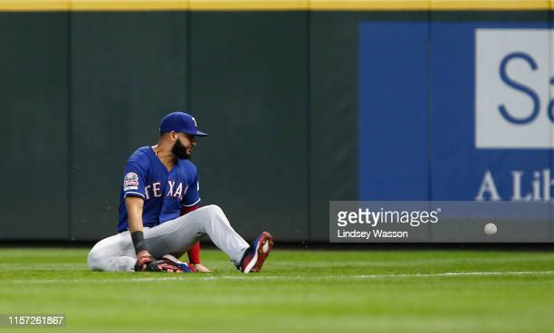 Nomar Mazara of the Texas Rangers can't field the single by Dylan Moore of the Seattle Mariners in the sixth inning at T-Mobile Park on July 22, 2019...