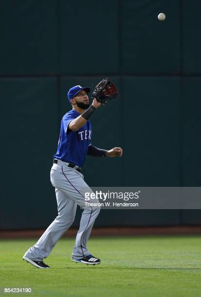 Nomar Mazara of the Texas Rangers catches a fly ball off the bat of Marcus Semien of the Oakland Athletics in the bottom of the first inning at...