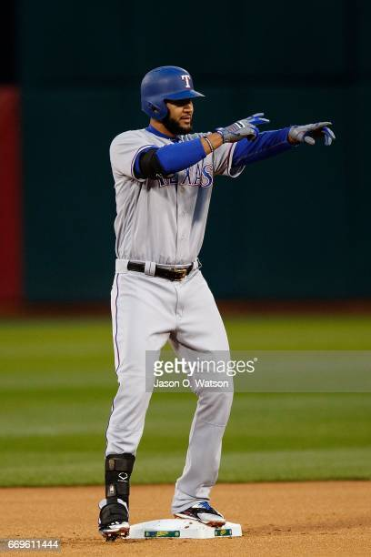 Nomar Mazara of the Texas Rangers celebrates after hitting an RBI double against the Oakland Athletics during the first inning at the Oakland...