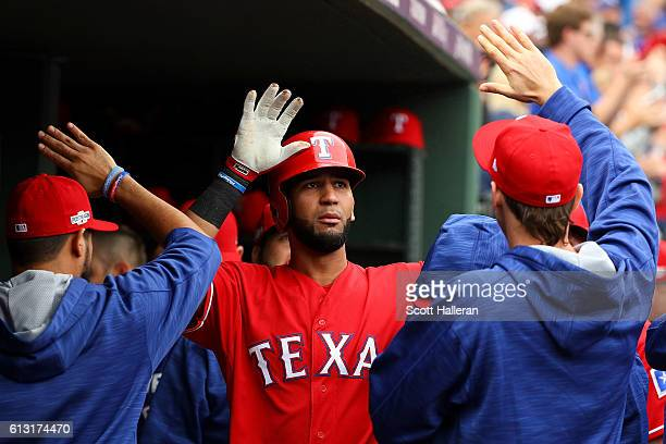 Nomar Mazara of the Texas Rangers celebrates with teammates after scoring against the Toronto Blue Jays in the fourth inning of game two of the...