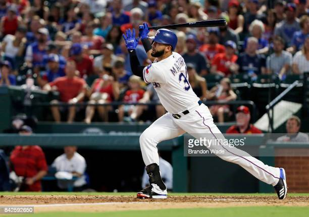 Nomar Mazara of the Texas Rangers fly's out to left field during the fifht inning of a baseball game against the Los Angeles Angels of Anaheim at...