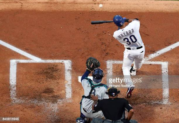 Nomar Mazara of the Texas Rangers hits a 2run double in the first inning against the Seattle Mariners at Globe Life Park in Arlington on September 11...