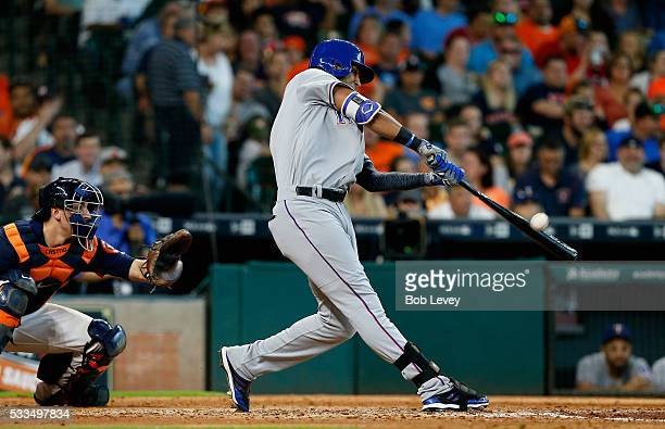 Nomar Mazara of the Texas Rangers hits a home run in the seventh inning against the Houston Astros at Minute Maid Park on May 22 2016 in Houston Texas