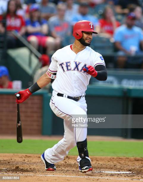 Nomar Mazara of the Texas Rangers hits a one run single in the first inning against the Chicago White Sox at Globe Life Park in Arlington on August...