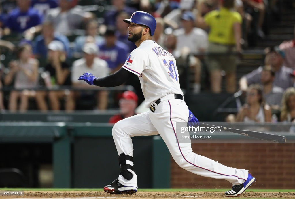 Nomar Mazara #30 of the Texas Rangers hits a rbi single against the Detroit Tigers in the fourth inning at Globe Life Park in Arlington on August 15, 2017 in Arlington, Texas.