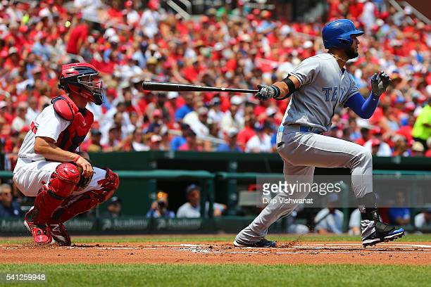 Nomar Mazara of the Texas Rangers hits a sacrifice RBI against the St Louis Cardinals in the first inning at Busch Stadium on June 19 2016 in St...