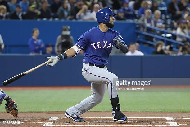 Nomar Mazara of the Texas Rangers hits a single in the first inning during MLB game action against the Toronto Blue Jays on May 4 2016 at Rogers...