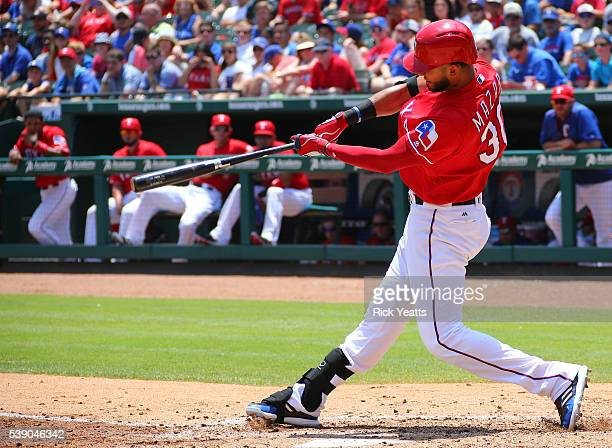 Nomar Mazara of the Texas Rangers hits a single RBI in the third inning against the Houston Astros at Globe Life Park in Arlington on June 9 2016 in...