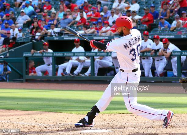 Nomar Mazara of the Texas Rangers hits a solo home run in the eighth inning against the Baltimore Orioles at Globe Life Park in Arlington on July 30...
