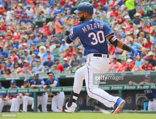 Nomar Mazara of the Texas Rangers hits in the first inning against the Houston Astros at Globe Life Park in Arlington on August 13 2017 in Arlington...